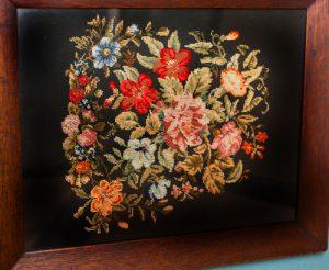 Framed needlework by Elizabeth Payne.
