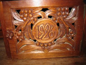 Close up carved date, table, Foxlease, England.